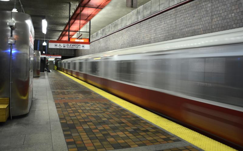 Alewife Red Line platform, with a train zipping past