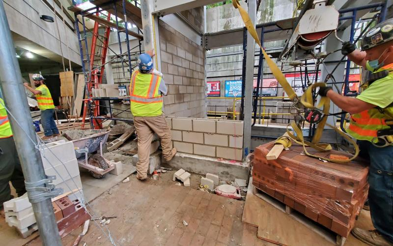 A construction crew working on the Red Line platform at Quincy Adams Station.