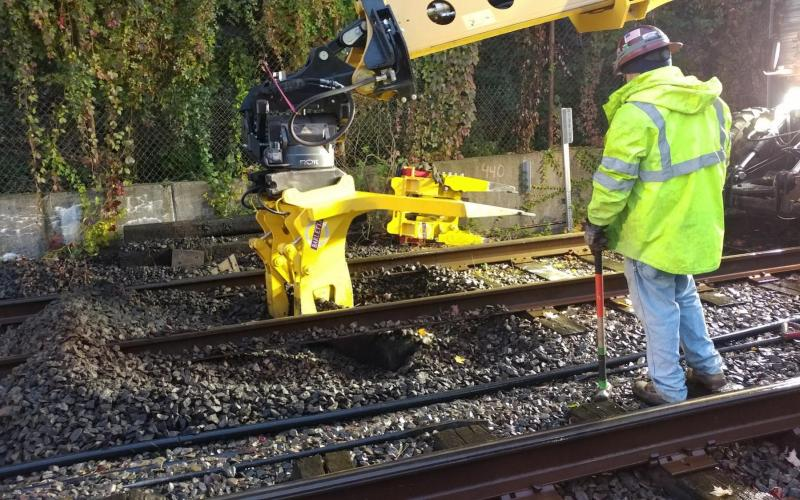 Removing ties along the tracks of the Green Line D branch.